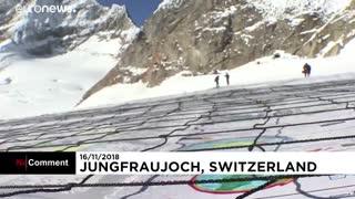 پیام کارت پستال غول پیکر در سوئیس: گرمایش زمین را متوقف کنید…
