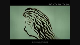 she is in the rain/the rose