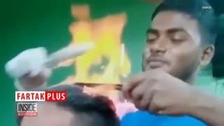 آرایشگری که موهای مشتریان خود را به آتش میکشد